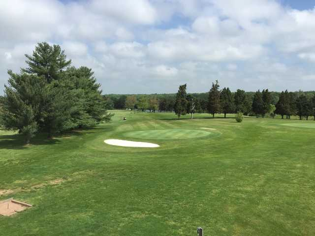 A sunny day view of a hole at Sterling Park Golf Club.