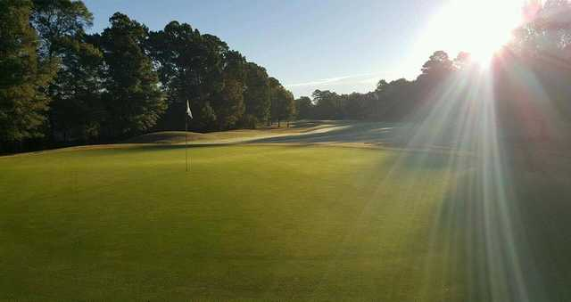 A sunny day view of a green at Kiln Creek Golf Club & Resort.