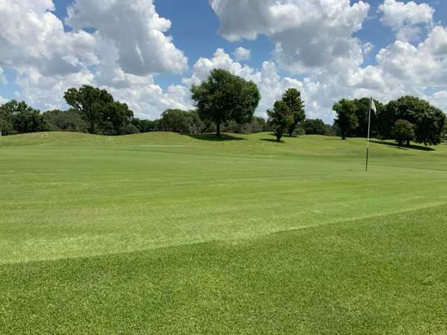 A sunny day view of a hole at The Spruce Creek Preserve Golf Club.