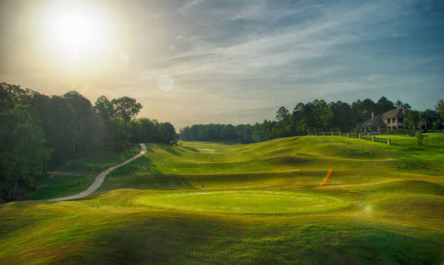 A sunny day view of a green at Tempest Golf Club.