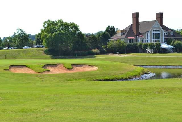 A view of the clubhouse and a green at Brickshire Golf Club.