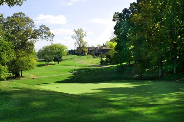 A sunny day view of a green at Toqua Golf Club.