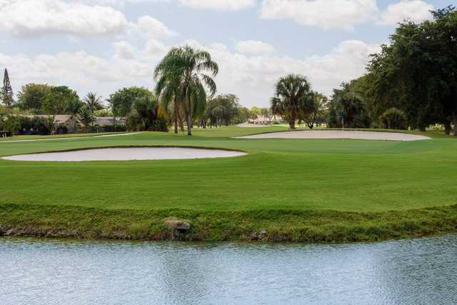 A view of a green with water and bunkers coming into play at Country Club of Coral Springs.