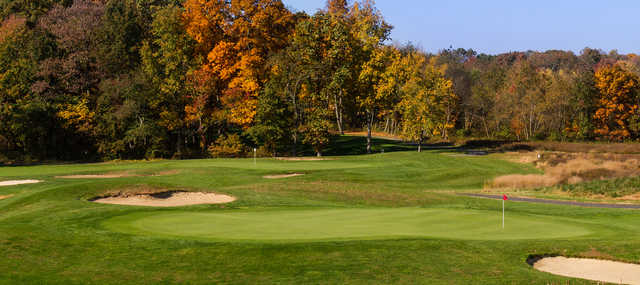 A fall day view of two greens at Princeton Country Club.