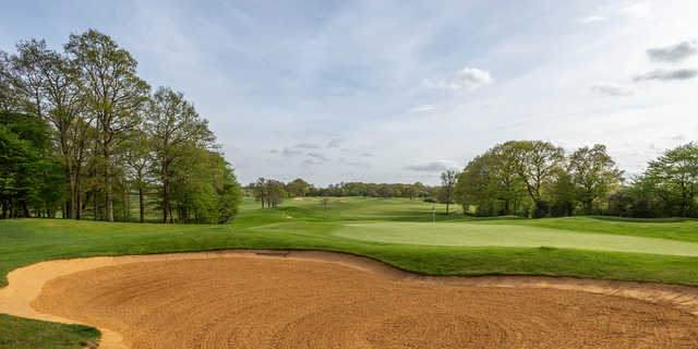 A view of a green protected by a huge bunker at Chart Hills Golf Club.