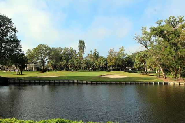 A view of a hole with water and bunkers coming into play at Boca Royale Golf & Country Club.