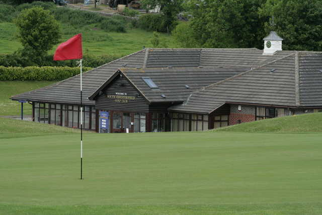 View of a green and the clubhouse at South Chesterfield Golf Club