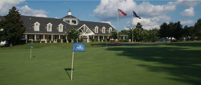 A view of the clubhouse and practice putting green at Lake Chesdin Golf Club.