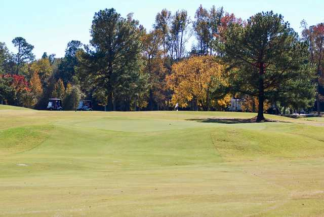 A fall day view of a green at Wendell Country Club.
