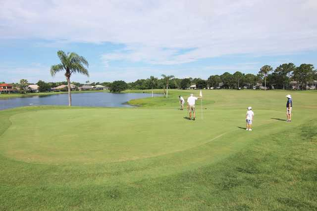 A sunny day view of a green at Spruce Creek Country Club.