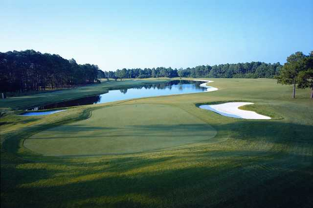 A view of a green with water coming into play at Perdido Bay Golf Club.