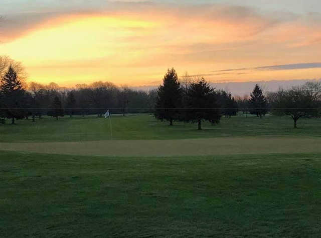 A sunset view of a hole at Homestead Golf Course.