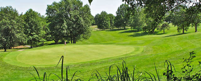 A sunny day view of a green at Hillcrest Golf & Country Club.