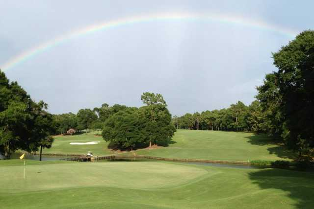 A view of a green and the rainbow over Rocky Bayou Country Club.