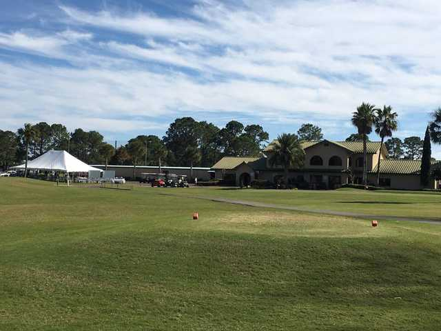 A view of a tee and the clubhouse at Holiday Golf Club.