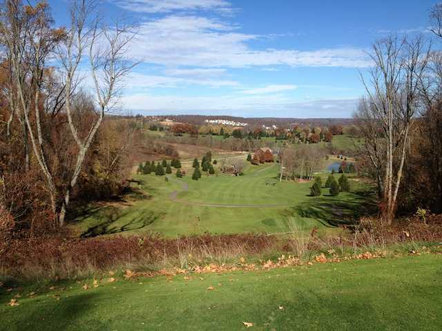 A view of a tee and fairway at Butler's Golf Course.