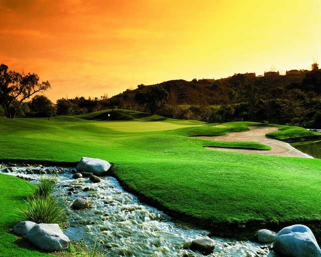 A sunset view of a green at Coyote Hills Golf Course.