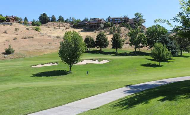 A sunny day view of a green at Crane Creek Country Club.