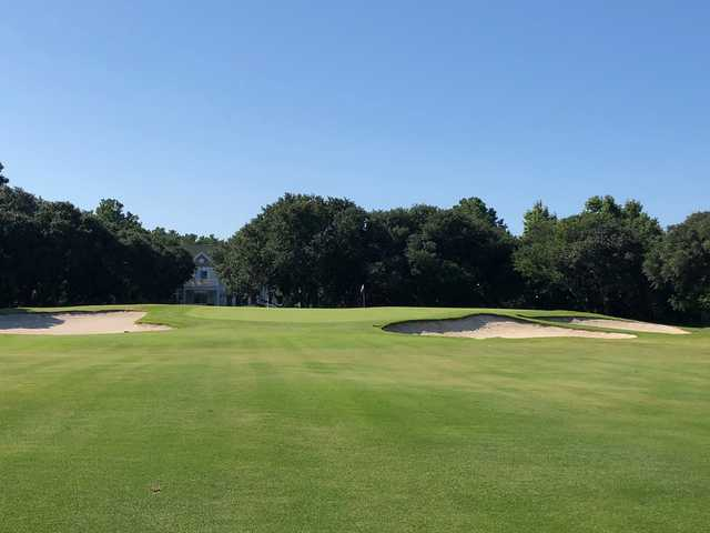 A view of hole #18 flanked by bunkers at The Currituck Club.