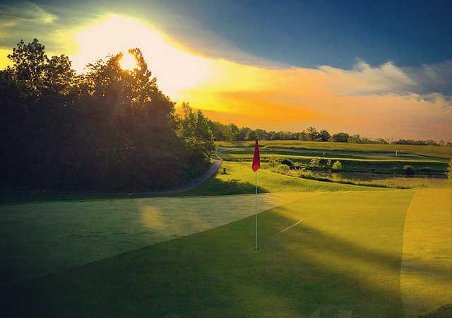 A sunset view of a hole at Norwoods Golf Club.
