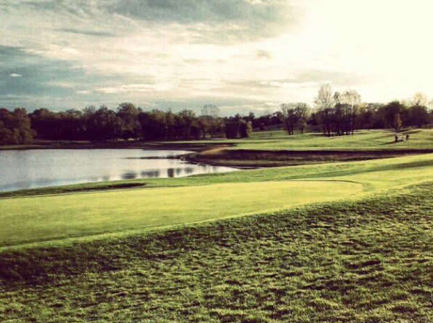 A view of a green with water coming into play at Norwoods Golf Club.