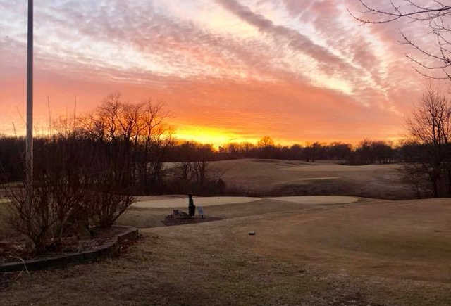 A sunset view of a tee at Drumm Farm Golf Club.