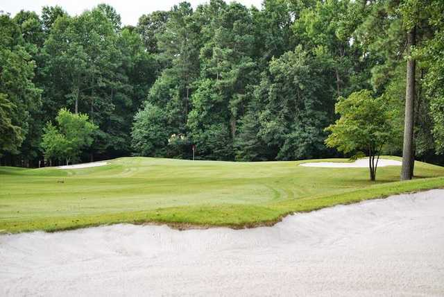 A view of a green flanked by bunkers at Blue Heron Course from Ford's Colony Country Club.