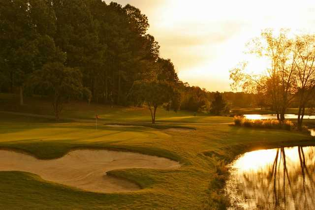 A sunset view of a hole at Ford's Colony Country Club.