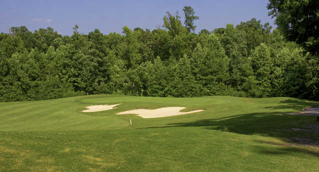 A sunny day view of a hole at Belmont Lake Golf Club.