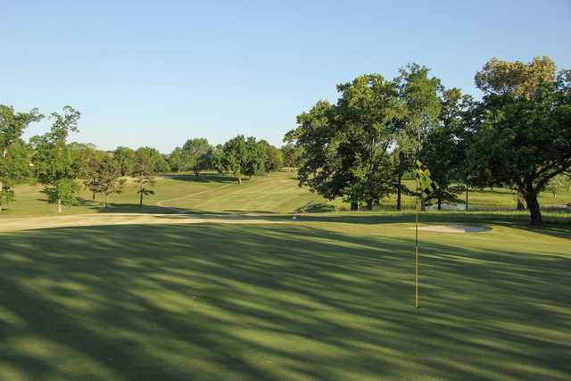A sunny day view of a green at Westwood Hills Country Club.