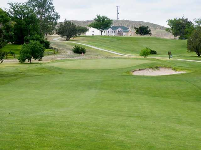 A view of a green guarded by a tricky bunker at Wray Golf Course.