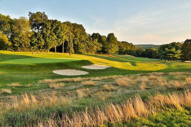 A view of a green protected by two tricky bunkers at Rock Ridge Country Club.