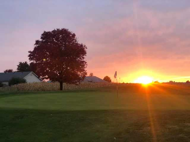 A sunset view of a hole at K's Creek Golf Club.