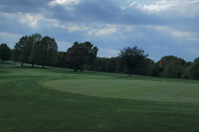 A cloudy day view of a green at Macon Country Club.
