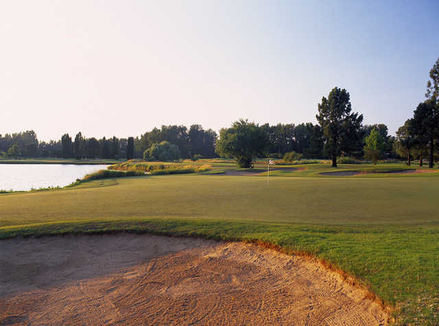 View of the 15th green from the Greenback Course at Heron Lakes Golf Club