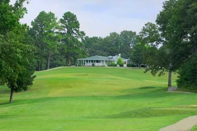 A view of hole #11 and the clubhouse at Jackson National Golf Club.
