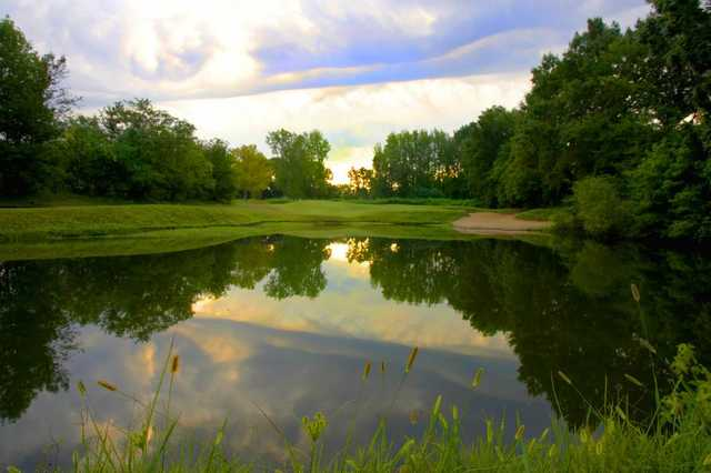 A view over the water of hole #2 at Jackson National Golf Club.