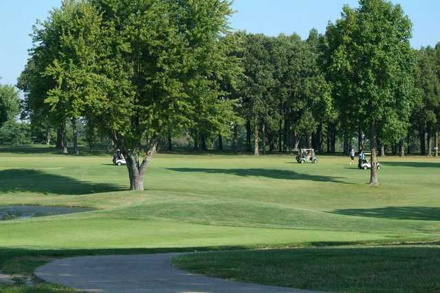 A view of a fairway at Whispering Oaks Golf Course.