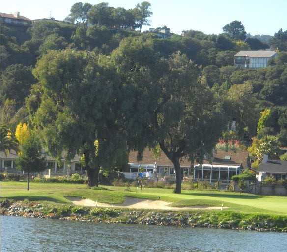 An inlet fronts the 166-yard, par-3 16th hole at Peacock Gap Golf Club in San Rafael.