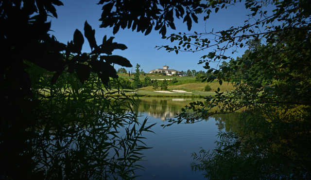 A view over the water of the clubhouse from Lonnie Poole Golf Course at North Carolina State University.