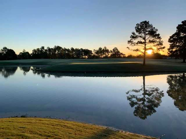A view over the water of the 16th green at Memorial Park Golf Course.