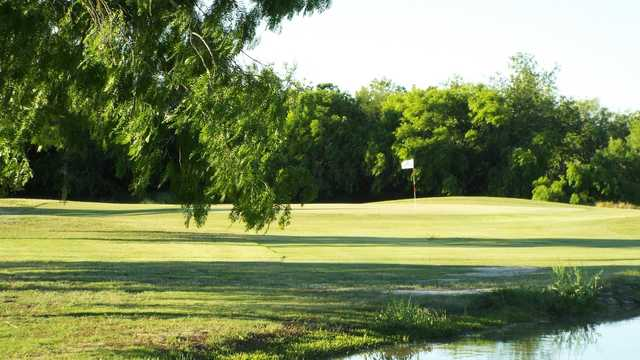 A sunny day view of a hole at Sinton Golf Course.