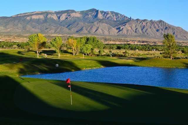 A summer day view of a green at Santa Ana Golf Club.