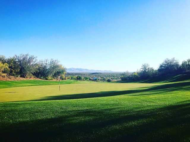 A sunny day view of a hole at Quintero Golf Club.