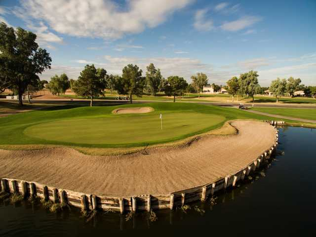 A view of a green with water and bunkers coming into play at Western Skies Golf Club.