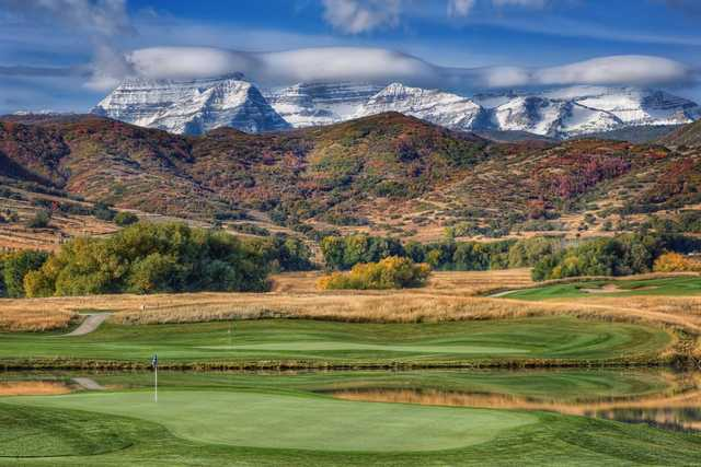 A fall day view of two greens at Soldier Hollow Golf Course.
