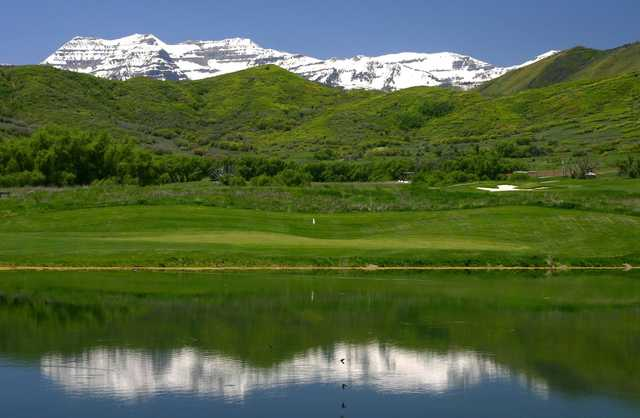 A view over the water of a hole at Soldier Hollow Golf Course.