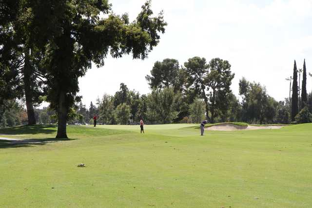 A sunny day view of a green at Stockdale Country Club.