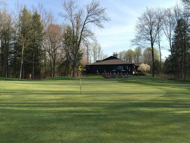 A spring day view of a green at The Ravines Golf Club.