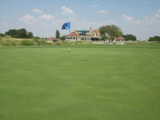 A view of a green and the clubhouse in the distance at The Tribute Golf Links.